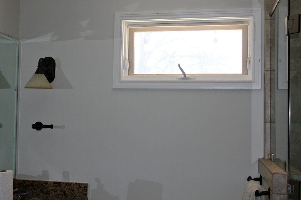 bathroom window before the stencil