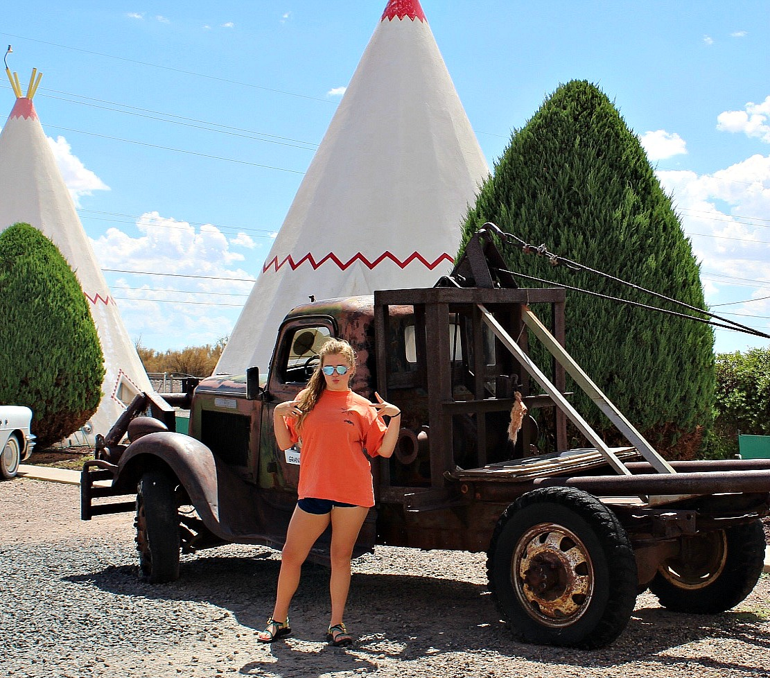 Daughter in cool pose in front of Mater at the Wigwam Hotel in Holbrook Arizona