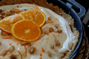 Orange Cream Dreamy Cast Iron Icebox Pie with orange zest macadamia nuts in a graham cracker crust