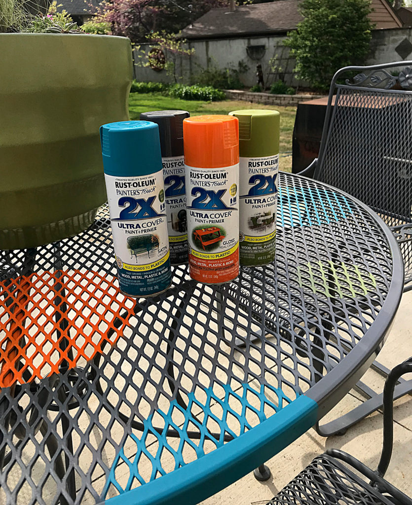 Rust-oleum Paint cans on the finished wrought iron redone with polkadots table