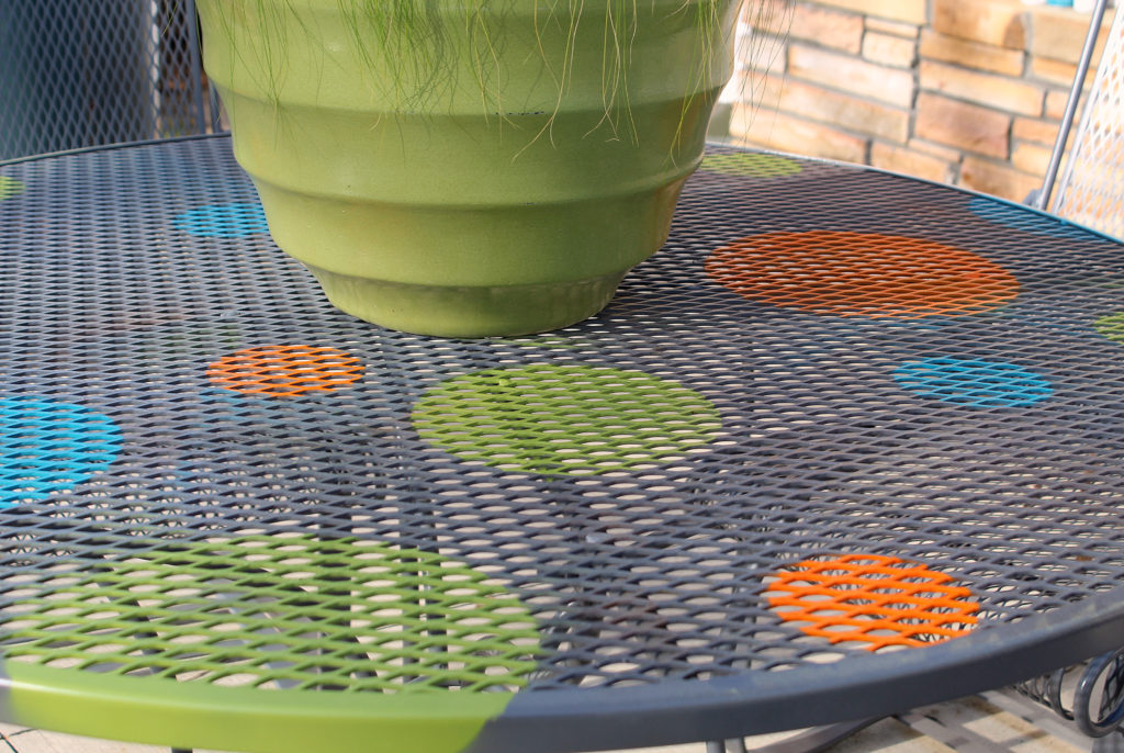 Redone Wrought Iron Patio Furniture on the back patio with a green planter