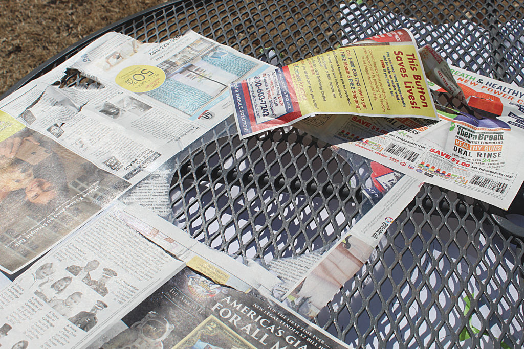 Circle Stencil on the table with protective newspaper