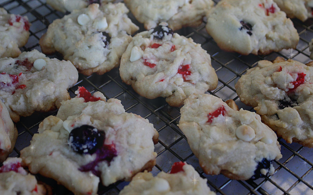 red white blueberry cookies on wire rack