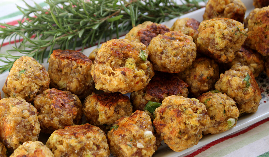 cooked sausage ball on a holiday tray with rosemary
