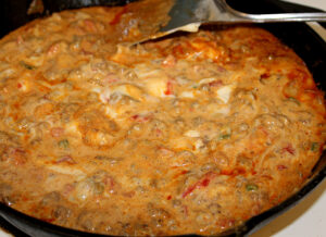 sausage rotel dip in a cast iron skillet
