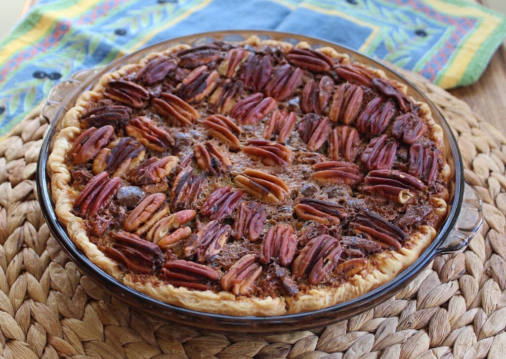 beautiful baked chocolate orange pecan pie in a glass pie plate