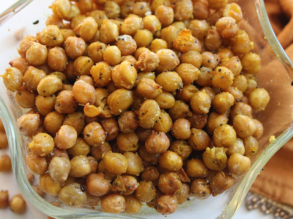 overhead close up of curry crunchy chickpeas in a glass bowl
