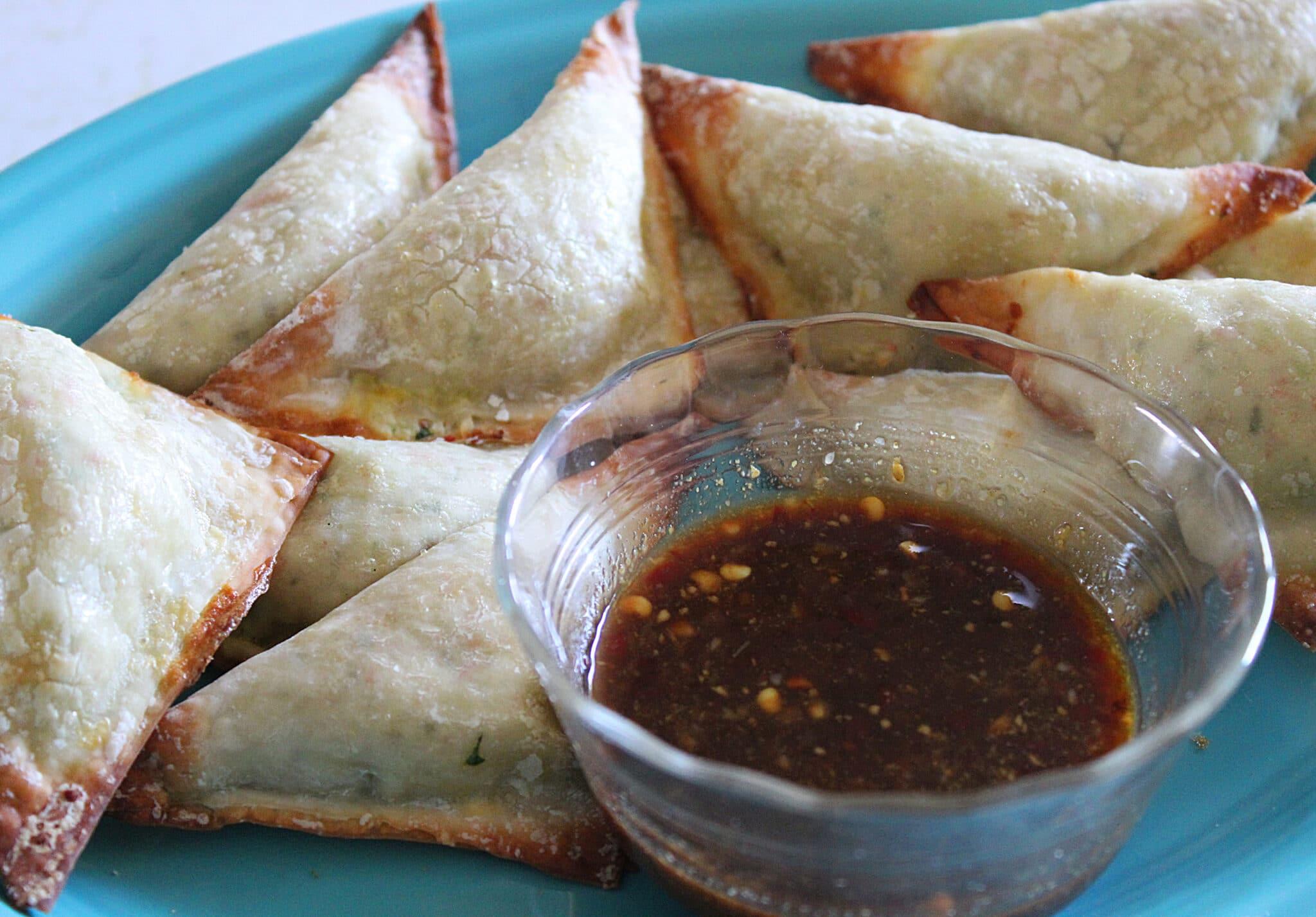 close up of spicy krab wonton with sweet mustard sauce