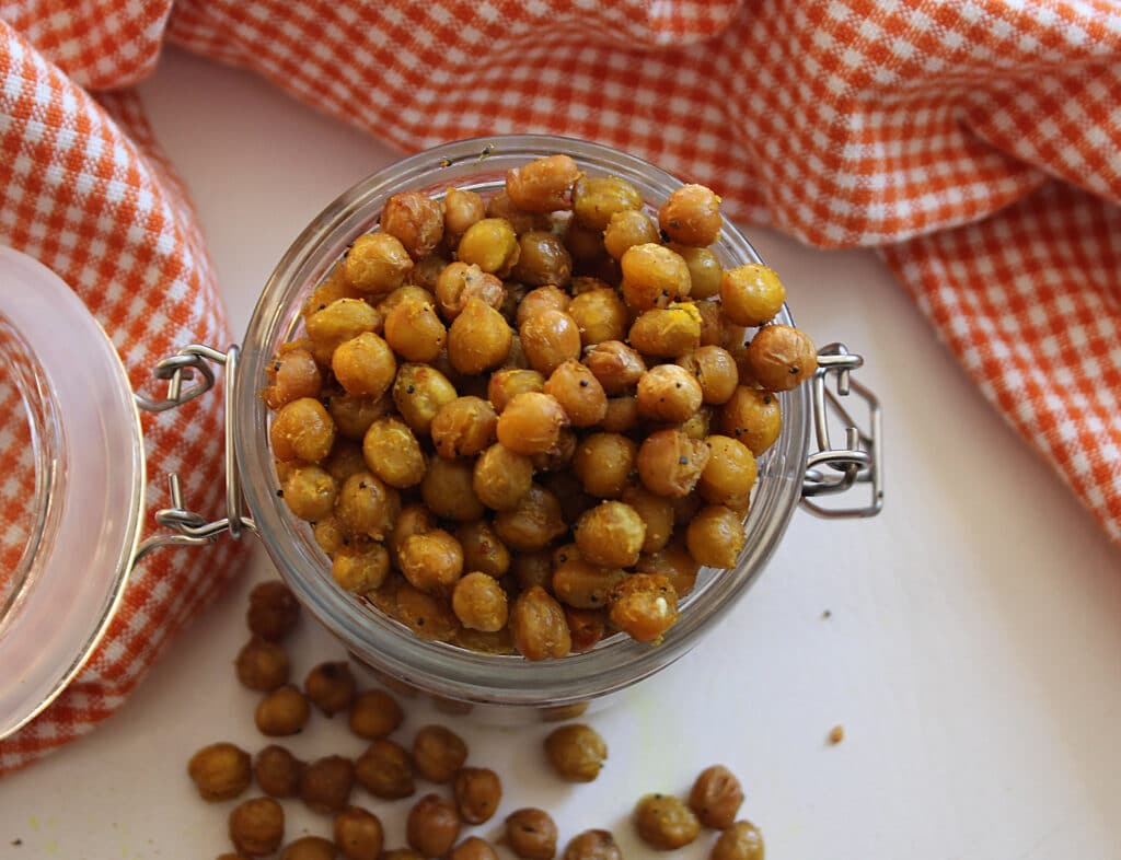 overhead shot of done curry crunchy chickpeas in a glass jar
