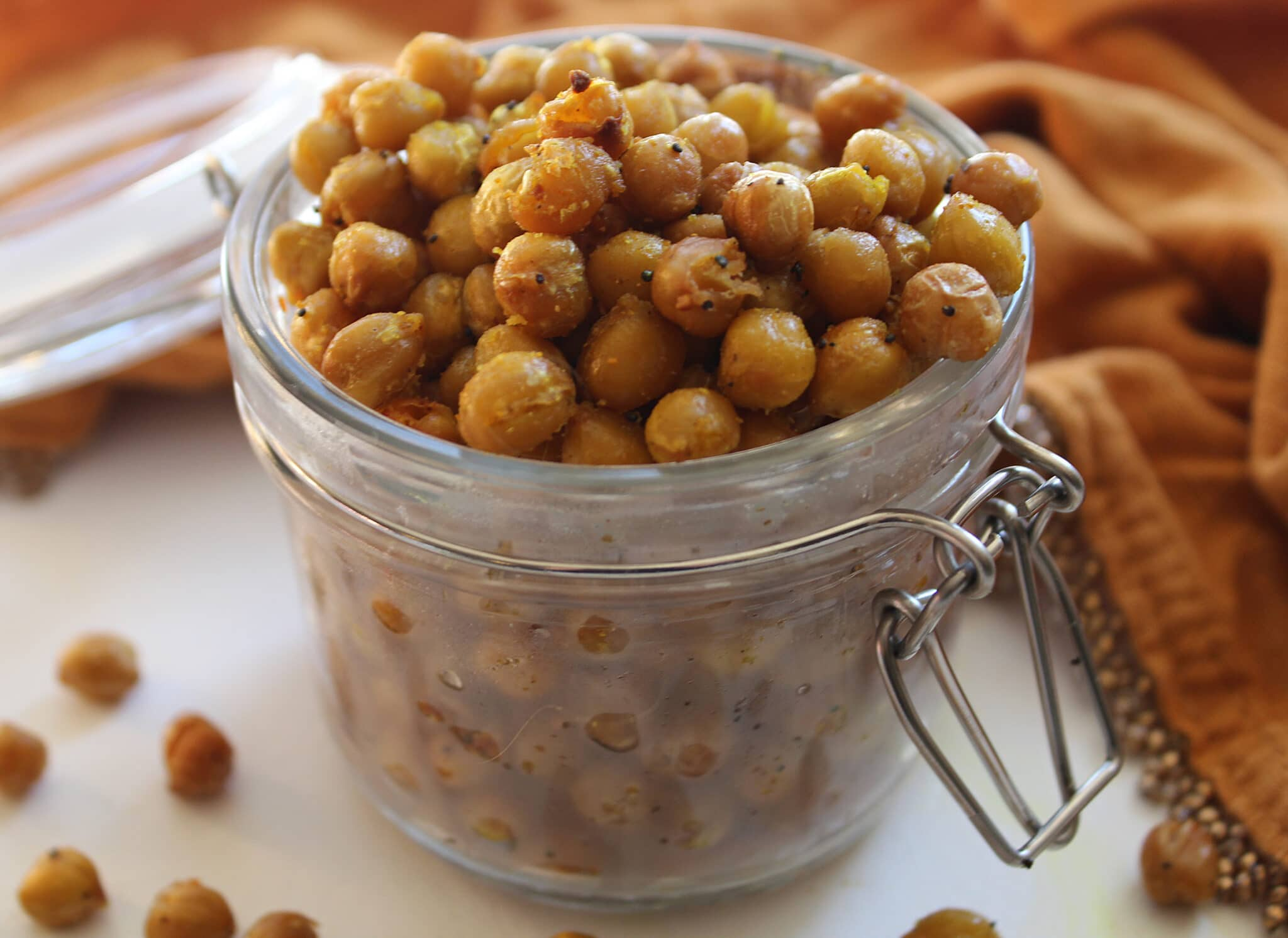 close up of curry crunchy chickpeas in a glass jar