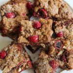 overhead of chocolate cherry chunk cookie bars on a white plate