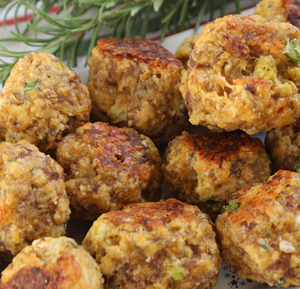 Sausage balls made with Bisquick on a holiday plate with fresh rosemary
