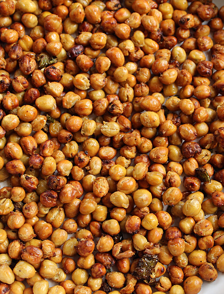 close up of finished golden brown spicy chickpeas with jalapenos