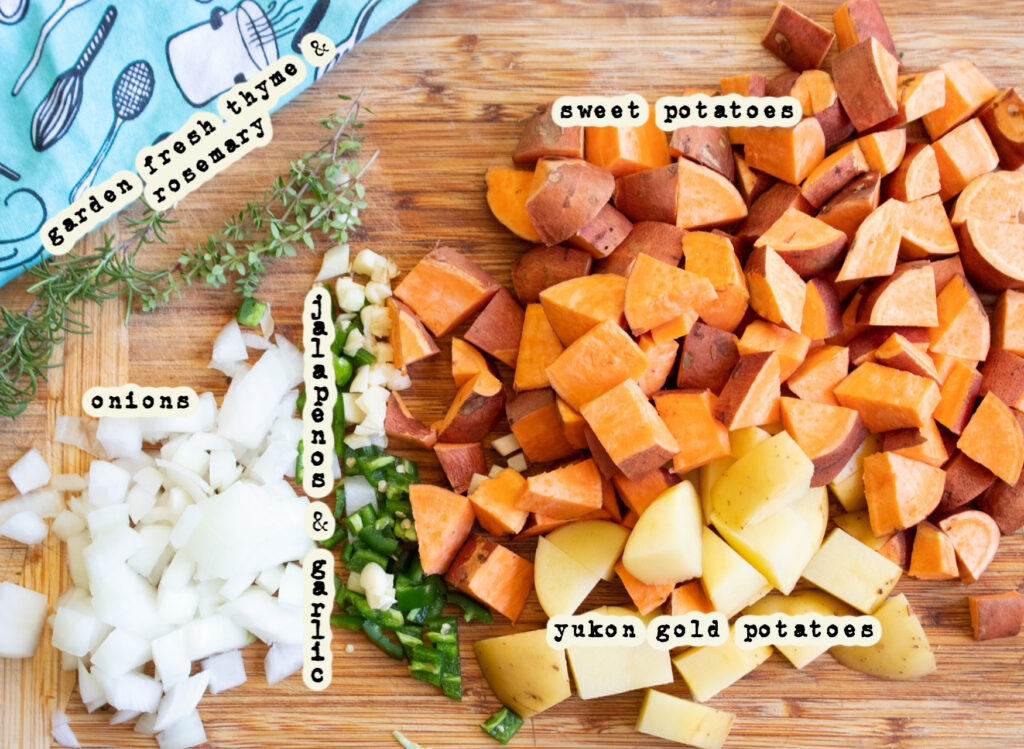 sweet potato hash ingredients on a butcher block board