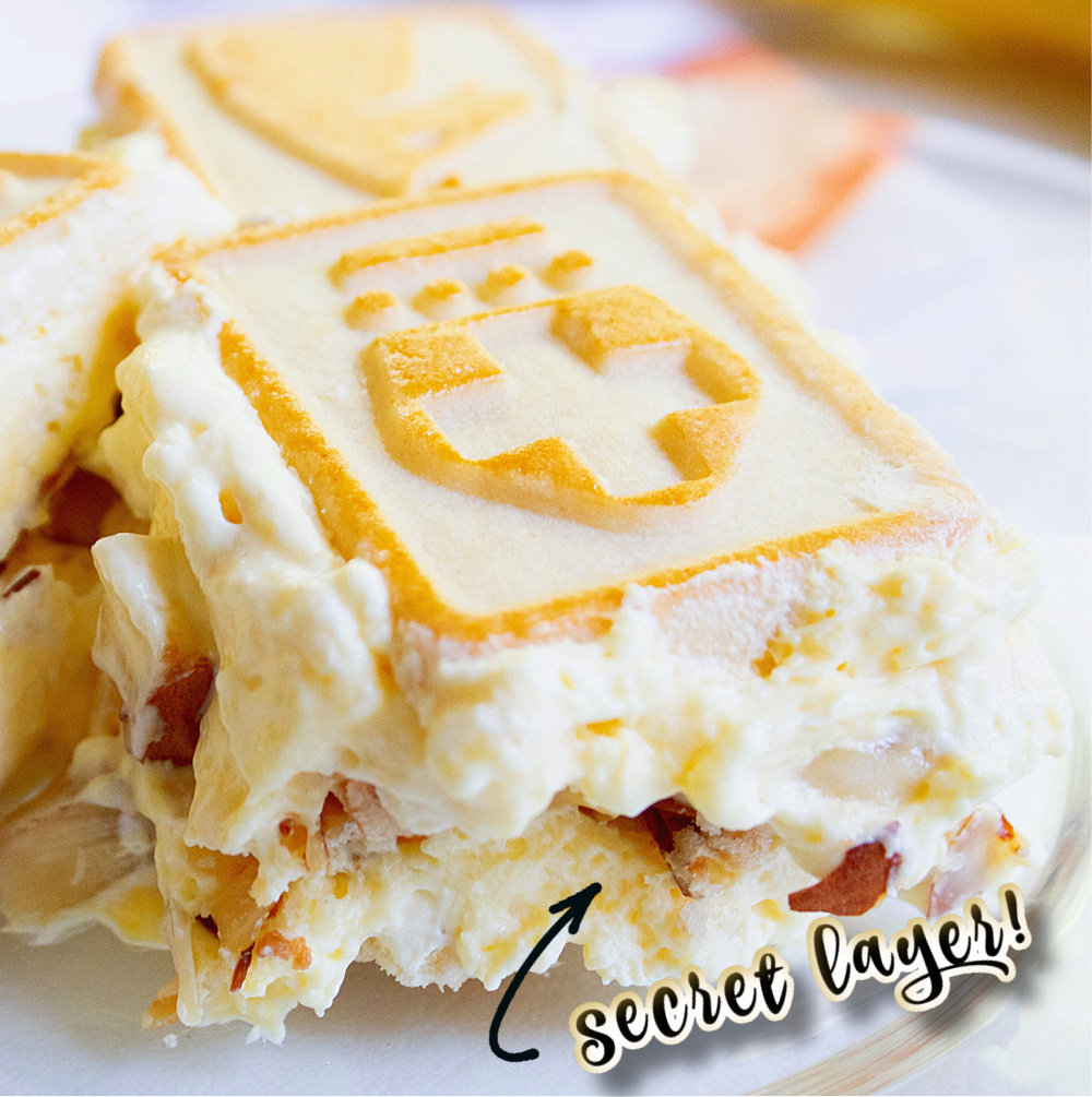 close up of single piece of banana pudding with a secret layer arrow
