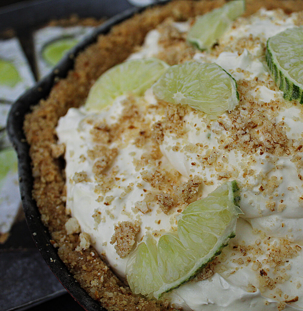 closeup of key lime cold cast iron pie with graham cracker crust