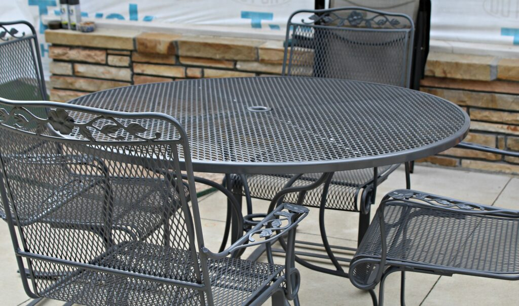 Finished redone dark grey just like new wrought iron table and chairs