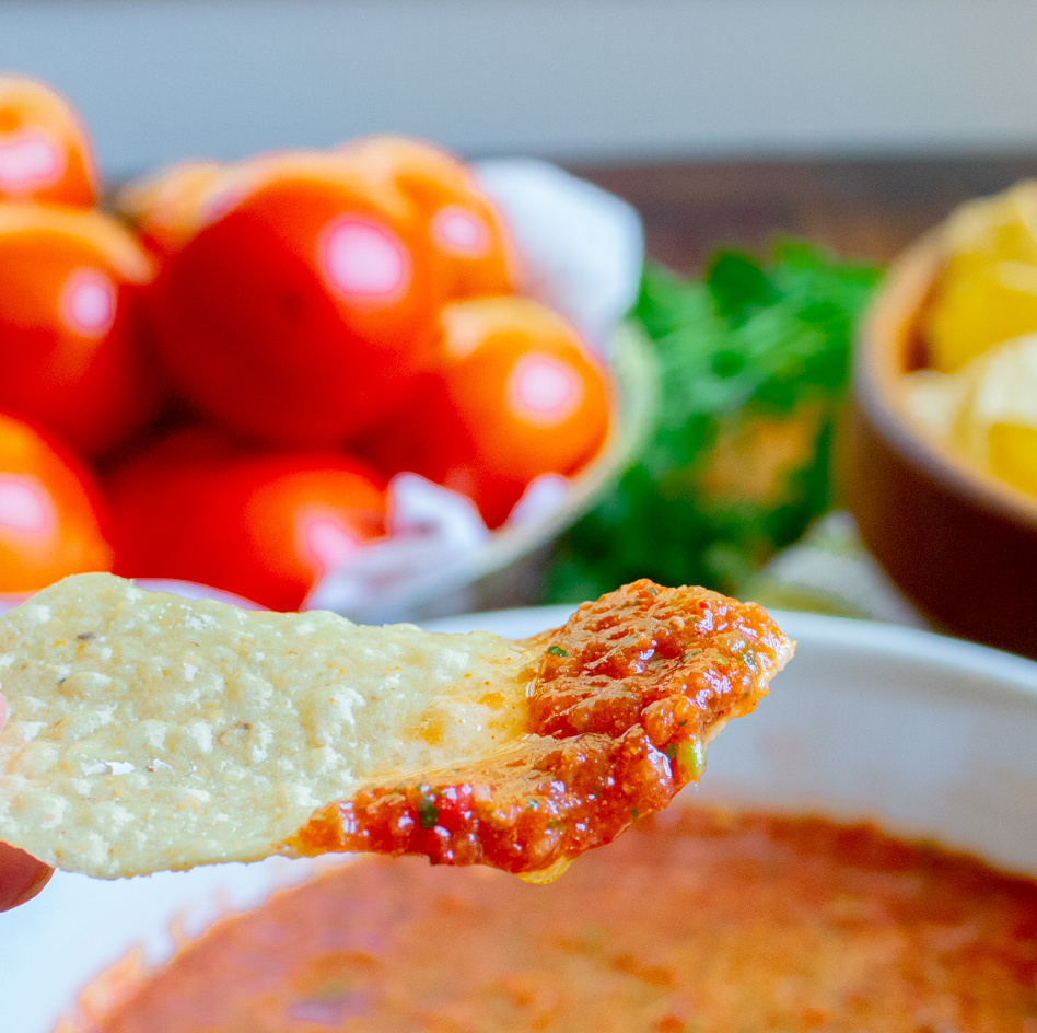 closup up of homemade salsa on a chip