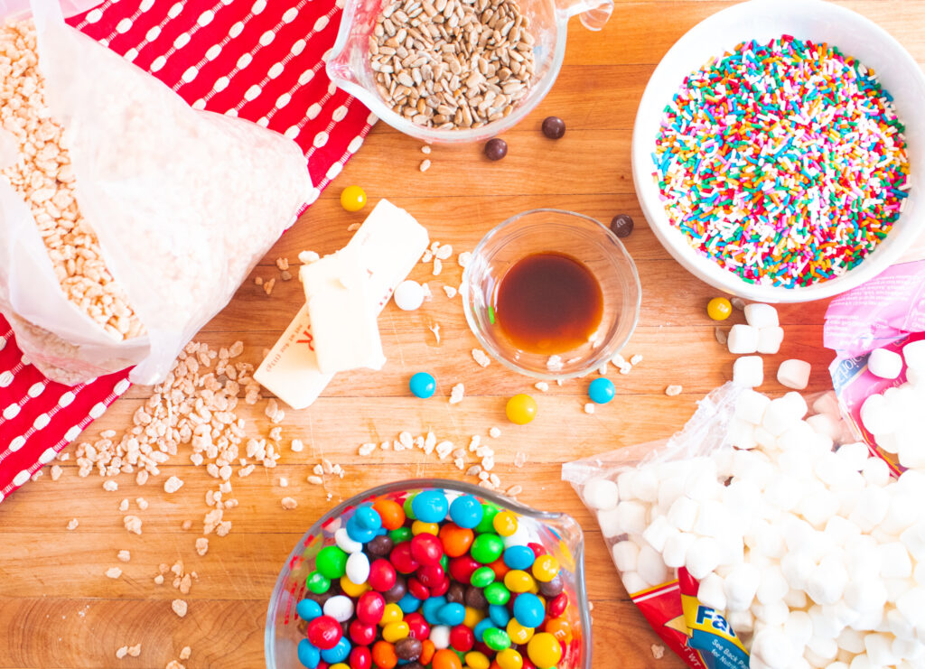 above picture of rice krispie treat ingredients on a butcher block with a red and white towel