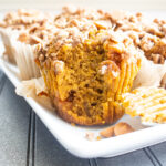closeup side view of pumpkin muffin with bite out of it