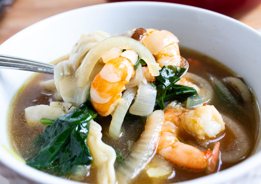 close up of shrimp, onions, spinach, wonton soup