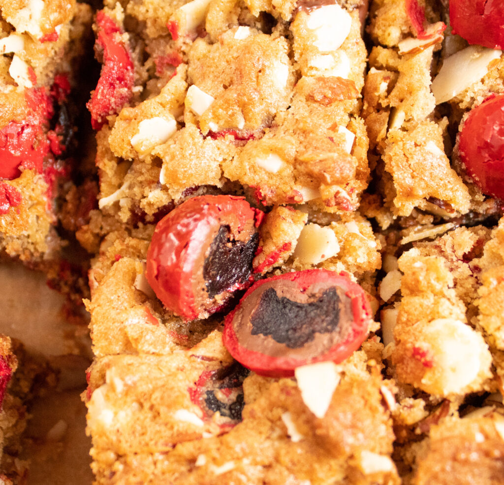 close up of delicious chocolate covered cherry chunk cookie bars