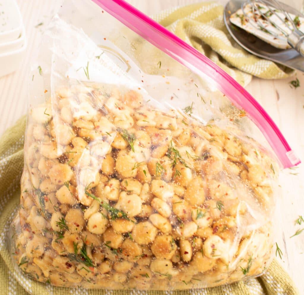 nmarinated italian garlic dill snack crackers in a gallon ziplock bag