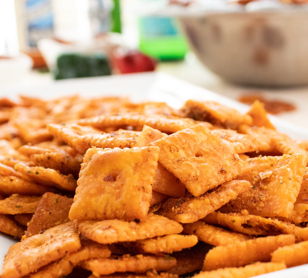 close up of feisty cheddar snack crackers on a white plate
