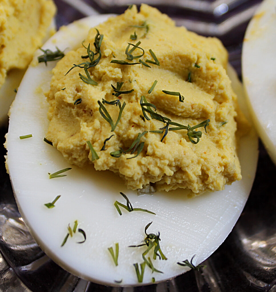 close up of a curry dill deviled egg