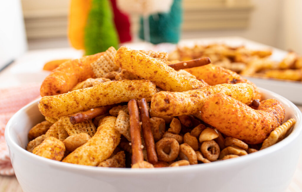 side view of homemade chex mix with cheetos
