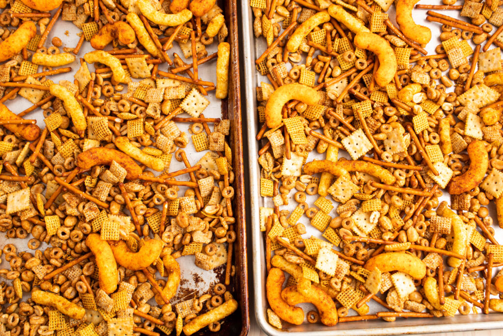 unbaked chex mix overhead on baking sheets